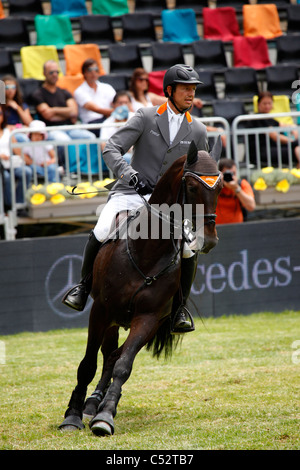 Marco Kutscher from Germany in action on the horse Satisfaction FRH. - Stock Photo