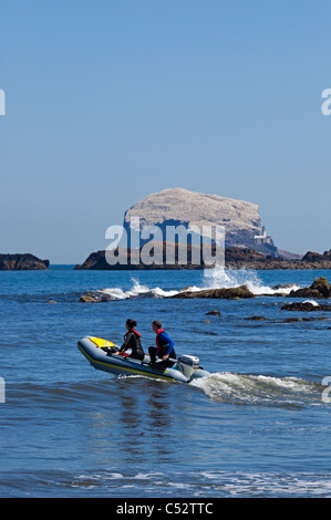 RIB with male female setting off from North Berwick East Lothian Scotland UK Europe - Stock Photo