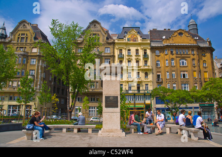 People relaxing at renovated Fövam ter square Budapest Hungary Europe - Stock Photo