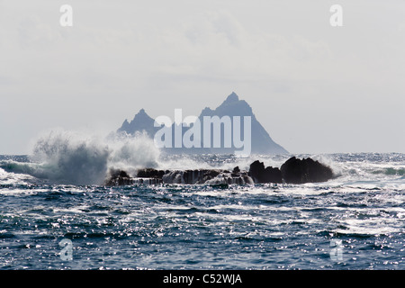Waves crashing on rocks at the Skelligs, County Kerry, Ireland - Stock Photo