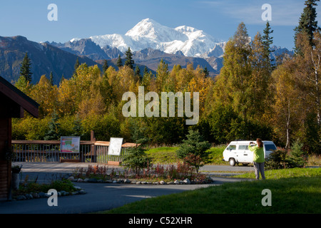 Woman at the Alaska Veteran's Memorial scenic overlook, Mt. Mckinley and Alaska Range, George Parks Highway, Alaska - Stock Photo