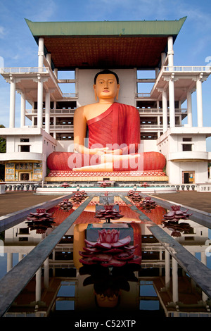 Giant sitting Buddha statue in the Weherahena temple of Matara, Sri Lanka, Asia - Stock Photo