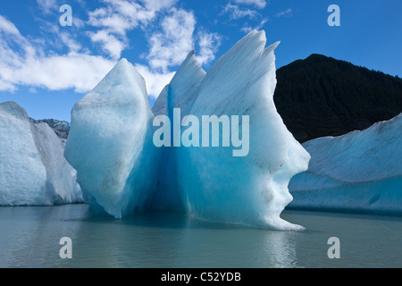 Sunny view of icebergs and Mendenhall Glacier terminus in Mendenhall Lake, Southeast Alaska, Summer - Stock Photo
