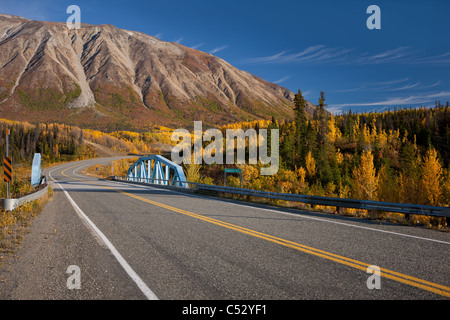 Scenic Autumn view along the Alaska Highway at the Takhanne River Bridge, Yukon Territory, Canada - Stock Photo