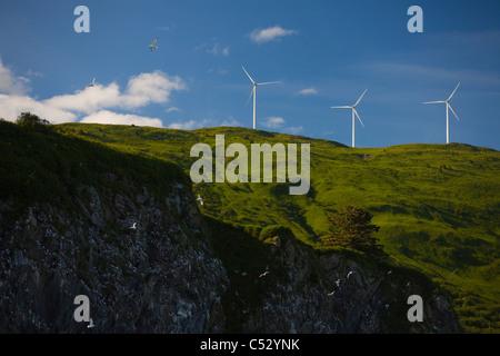 Pillar Mountain Wind Project wind turbines stand on Pillar Mountain on Kodiak Island, Southwest Alaska, Summer - Stock Photo