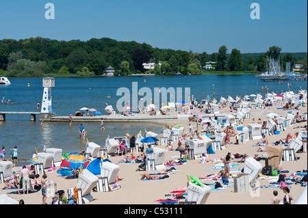 Busy beach at Strandbad in Wannsee in Berlin Germany - Stock Photo