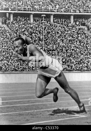 JAMES 'JESSIE' OWENS (1913-1980) American athlete at the 1936 Summer Olympic Games where he won four gold medals - Stock Photo