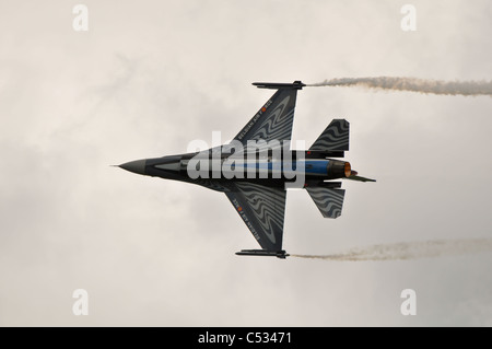 f-16 fighter jet doing aerobatics at an airshow - Stock Photo
