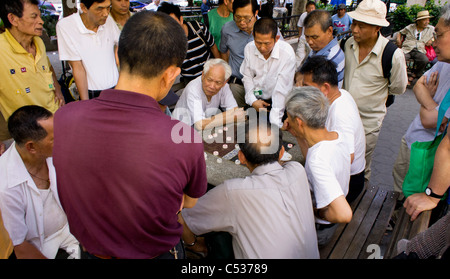Asian men playing Chinese chess in Chinatown, New York - Stock Photo