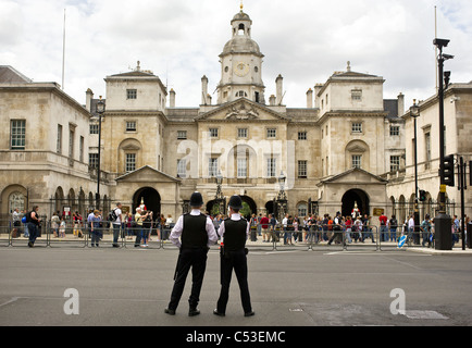 Two Metropolitan Police Officers on duty outside Horse Guards in London. - Stock Photo