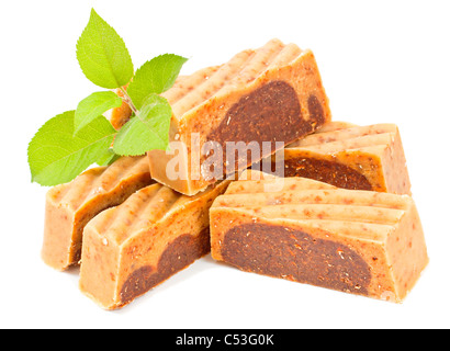 Handmade soap with green twig on white background. - Stock Photo