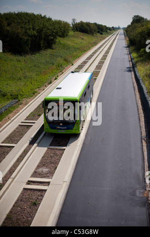 Guided bus on new guided busway running from Cambridge to St Ives. Brand new public transport technology. - Stock Photo