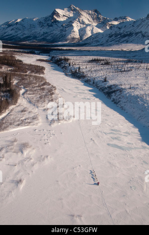 Dog team mushing on the North Fork of the Koyukuk River in Gates of the Arctic National Park, Alaska - Stock Photo