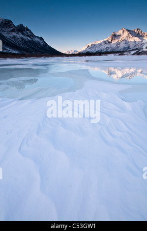 Alpenglow on Boreal Mountain reflects on overflow ice, in Gates of the Arctic National Park, Alaska - Stock Photo