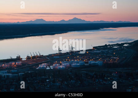 Aerial evening view of the Port of Anchorage with Mt. Foraker, Mt. Hunter and Mt. McKinley in the background, Alaska, - Stock Photo