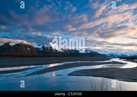 Morning light over the Chugach Mountains reflects in the braided Scott River in the Chugach National Forest, Alaska, - Stock Photo