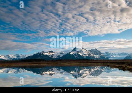 Alaganik slough reflects in the Chugach Mountains and cirrocumulus, Chugach National Forest, Cordova, Alaska - Stock Photo