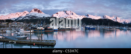 Evening alpenglow on the Chugach Mountains and Mt. Eyak behind the boat harbor at Cordova, Southcentral Alaska, - Stock Photo