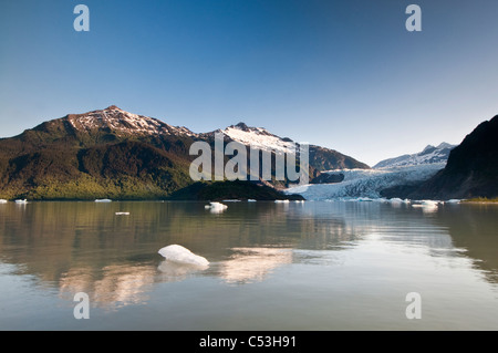 Scenic view of  icebergs floating in Mendenhall Lake with Mendenhall Glacier in the background,  Juneau, Alaska - Stock Photo