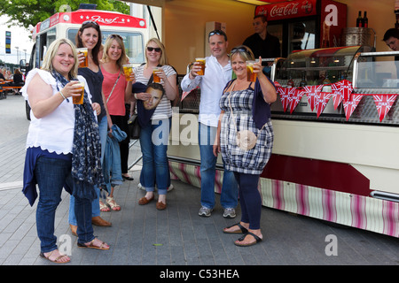 TAKE THAT fans pose for the camera outside a refreshment bar at Wembley Stadium just one hour before the Saturday - Stock Photo