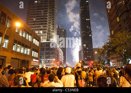 Thousands of spectators line the streets in New York to view the 35th annual Macy's Fourth of July fireworks - Stock Photo