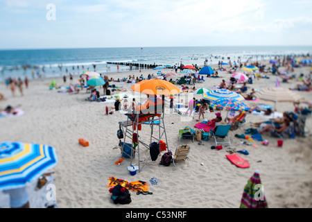 Beachgoers  at Rockaway Beach in the Queens borough of New York - Stock Photo