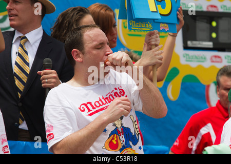 Joey Chestnut eating one of the 62 hot dogs that earned him the men's title at the 2011 Nathan's Famous Hot Dog - Stock Photo