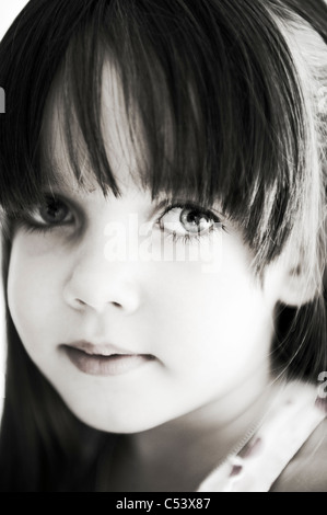 close up of a Gorgeous white young girl looking directly into the camera - Stock Photo