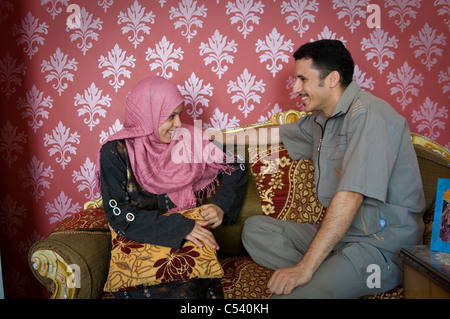 EGYPT, FAYOUM: Newly wed couple Mahmoud Abdel Baki and Fatma Soliman Mohamed in Gablaa village. She is only 16. - Stock Photo