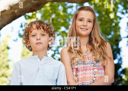 Brother and sister looking at camera - Stock Photo