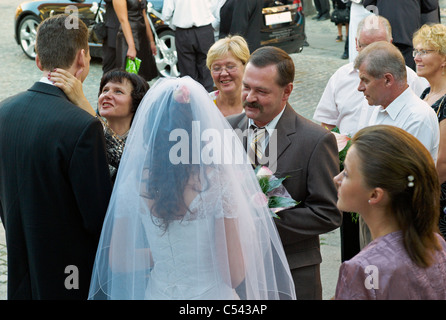A bridal couple receiving gifts and congratulations, Wroclaw, Poland - Stock Photo