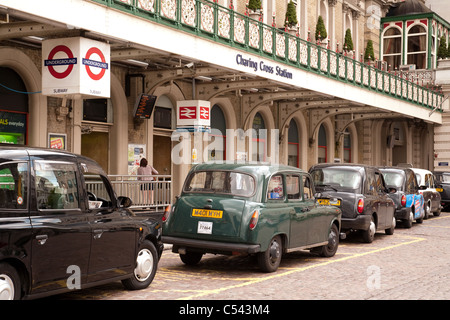 Taxi rank of London taxis, Charing Cross station, the Strand, London UK - Stock Photo