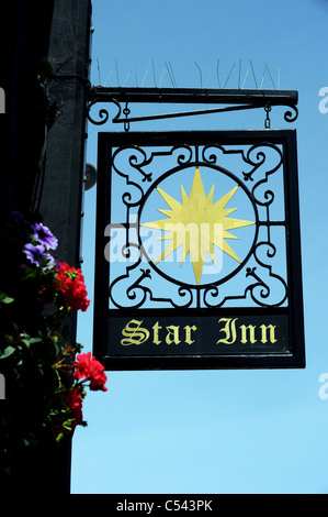 Sign outside the Star Inn in the centre of Alfriston, it dates back from 1345 making it one of England's oldest - Stock Photo