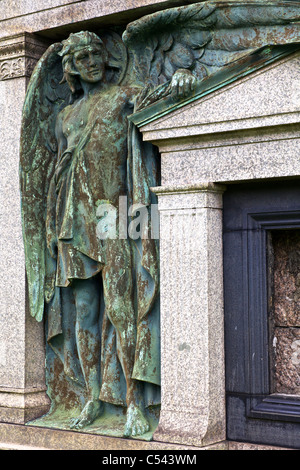 An angel, in copper, on a mausoleum in the Necropolis, Glasgow, Scotland, UK - Stock Photo