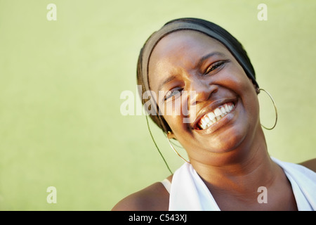 portrait of happy african adult woman looking at camera and smiling. Horizontal shape, copy space