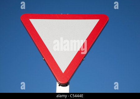 Blank Give Way Sign against Blue Sky Background - Stock Photo