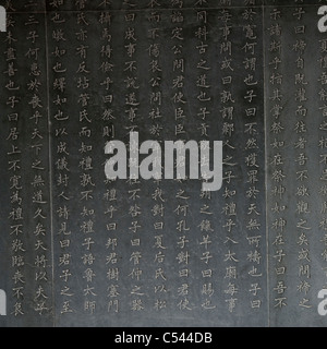 Chinese script engraved on a wall, Shanghai, China - Stock Photo