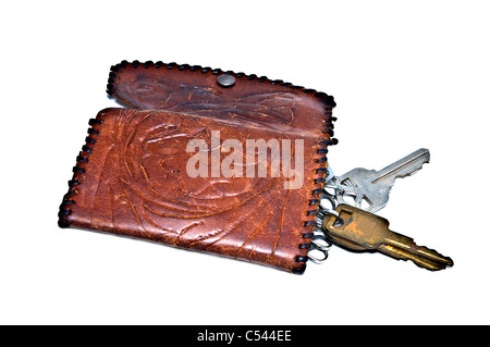An old handmade leather wallet for keys. - Stock Photo