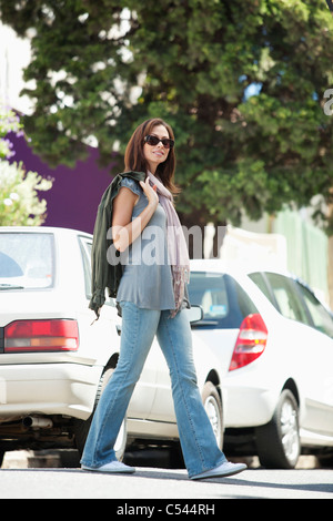 Portrait of a beautiful young woman wearing sunglasses - Stock Photo