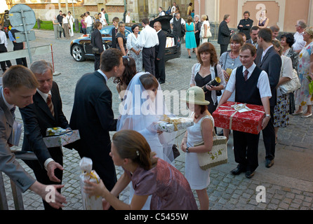 A bridal couple receiving gifts on the Cathedral Island, Wroclaw, Poland - Stock Photo