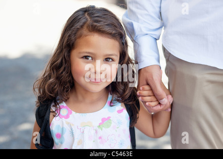 Portrait of a little girl holding her father's hand - Stock Photo