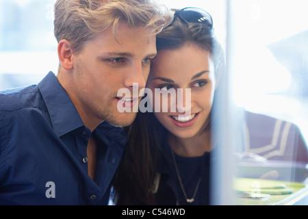 Young couple doing window shopping - Stock Photo