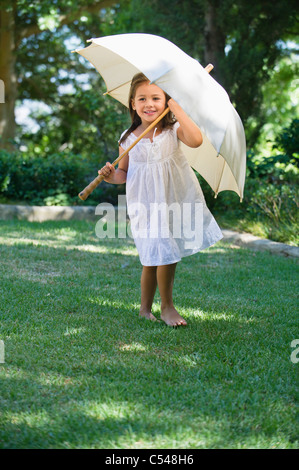 Cute little girl holding an umbrella - Stock Photo