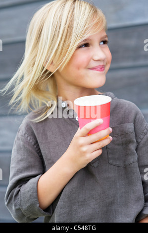 Girl holding a coffee cup and smiling