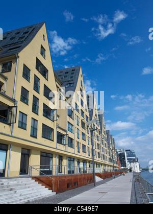 Modern Rheinauhafen property development along Rhine riverbank in Cologne Germany - Stock Photo