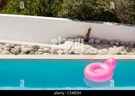 Inflatable ring floating on water in pool - Stock Photo