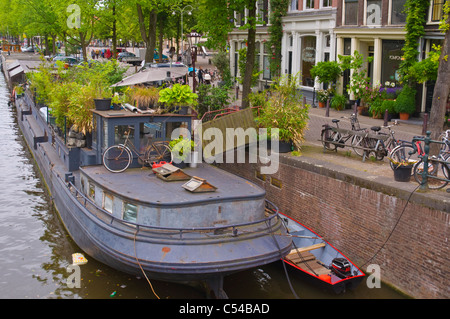 House boat on Prinsengracht canal central Amsterdam the Netherlands Europe - Stock Photo