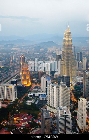 Petronas Twin Towers, view from Menara TV Tower, the fourth largest telecommunications tower in the world, Kuala - Stock Photo