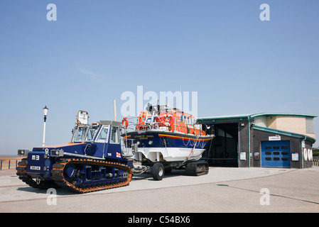 Lytham St Annes, England, UK. RNLI station lifeboat on wheeled trailer with tractor towing for crossing beach on - Stock Photo