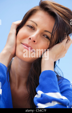 Close-up of a woman day dreaming - Stock Photo